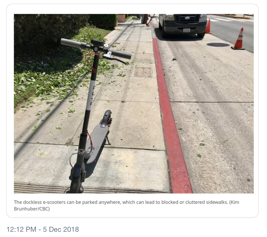 Dockless scooter left in middle of sidewalk, Austin 2018