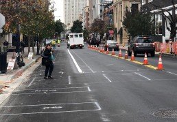J Street receiving the first stripe for the Downtown cycletrack